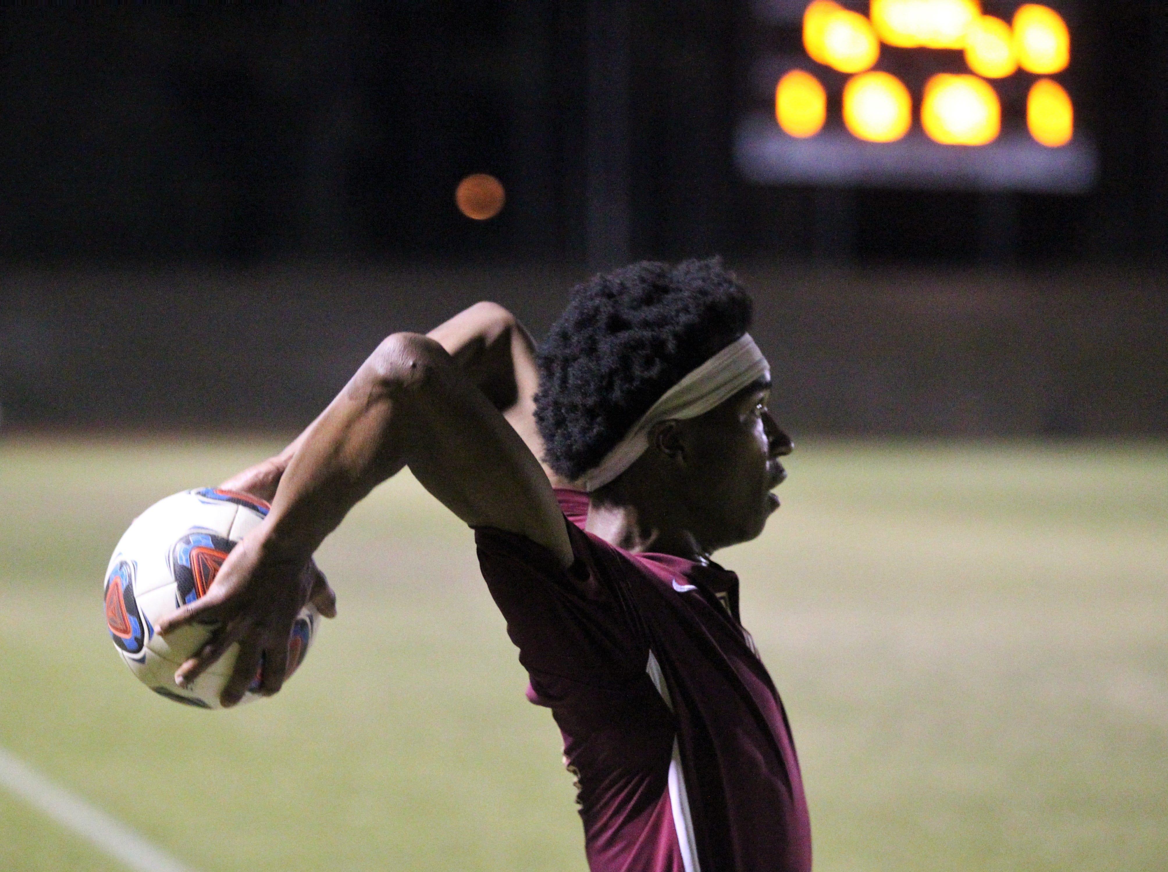 Florida High's Burnic Jordan makes a throw-in as Florida High's boys soccer team beat South Walton 2-0 during a Region 1-2A quarterfinal on Feb. 6, 2018.