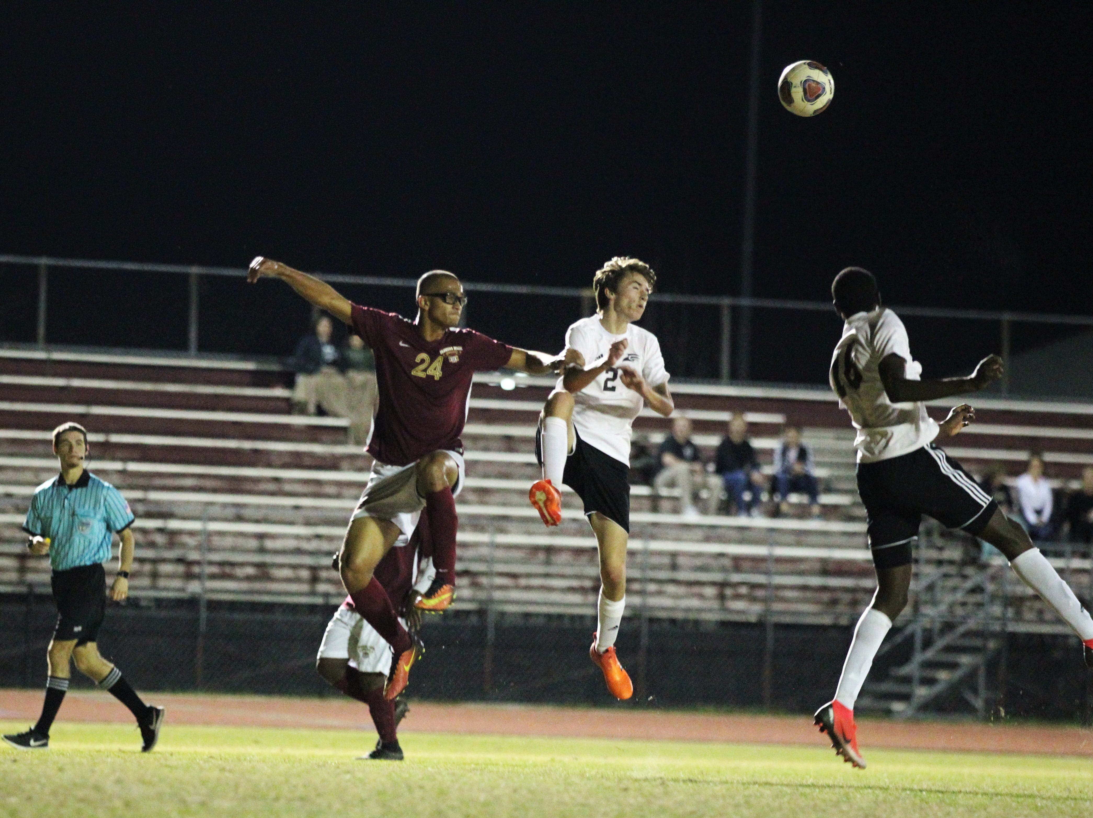 Florida High's Kelan Simmons goes airborne for a cross into the box as Florida High's boys soccer team beat South Walton 2-0 during a Region 1-2A quarterfinal on Feb. 6, 2018.