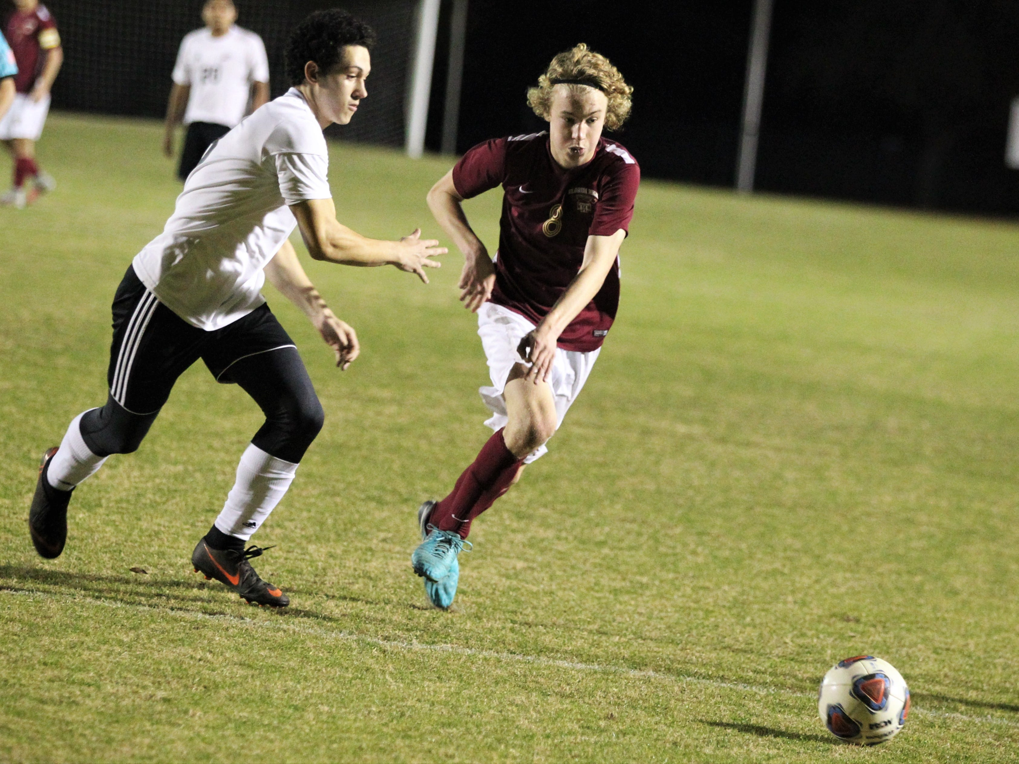 Florida High's Beecher Lewis races to a pass as Florida High's boys soccer team beat South Walton 2-0 during a Region 1-2A quarterfinal on Feb. 6, 2018.