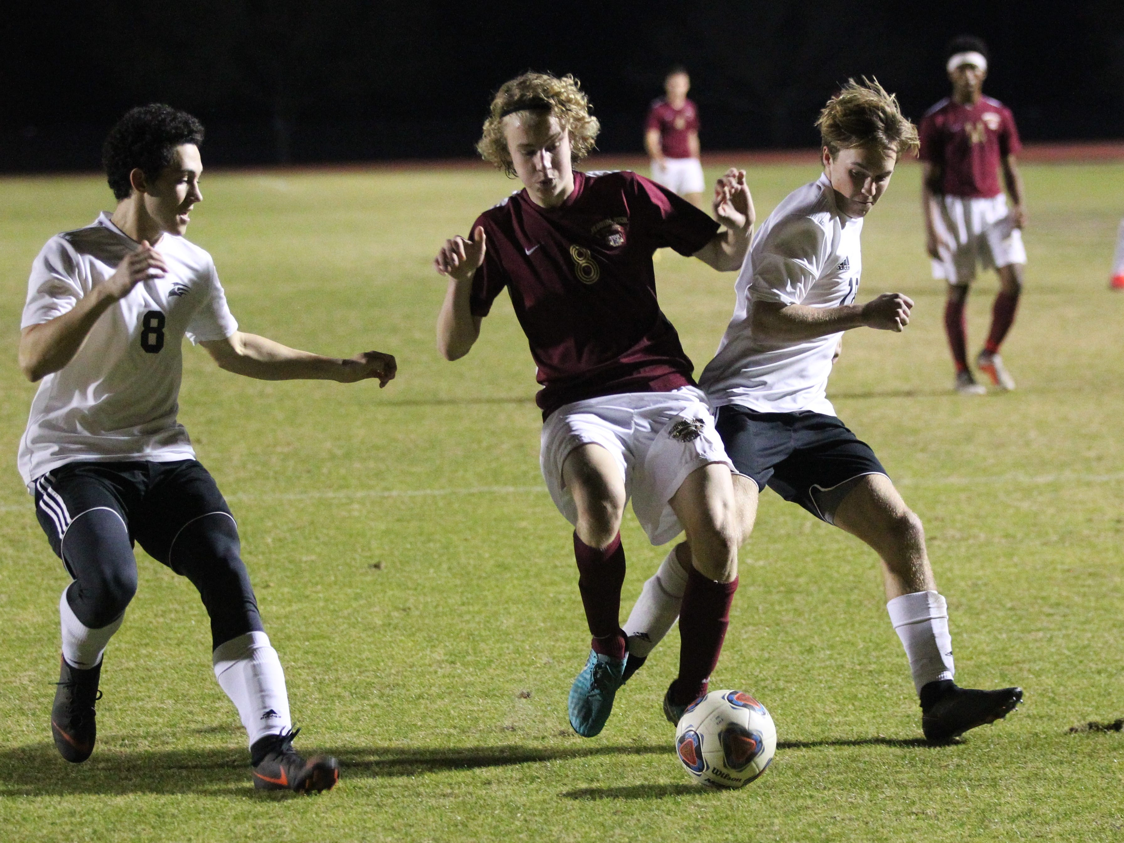 Florida High's Beecher Lewis fight for possession as Florida High's boys soccer team beat South Walton 2-0 during a Region 1-2A quarterfinal on Feb. 6, 2018.