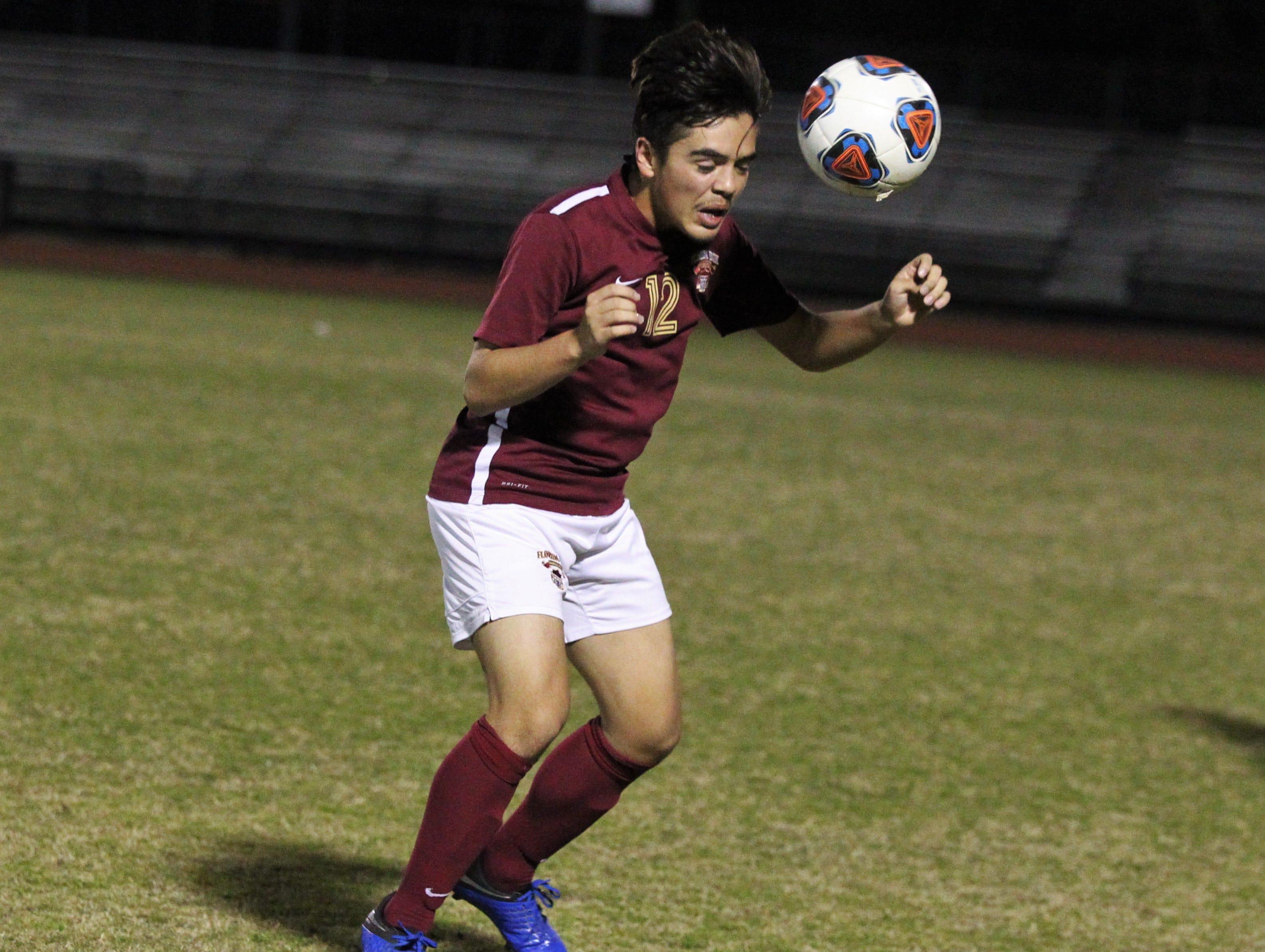 Florida High's Josh Limburg heads a ball forward as Florida High's boys soccer team beat South Walton 2-0 during a Region 1-2A quarterfinal on Feb. 6, 2018.