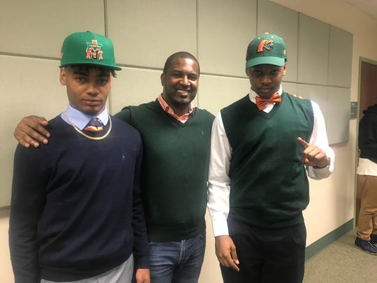 Wide receiver Donovan Mobley (left) joins his new head coach Willie Simmons and teammate Javan Morgan inside the FAMU College of Pharmacy on National Signing Day on Wednesday, Feb. 6, 2019.