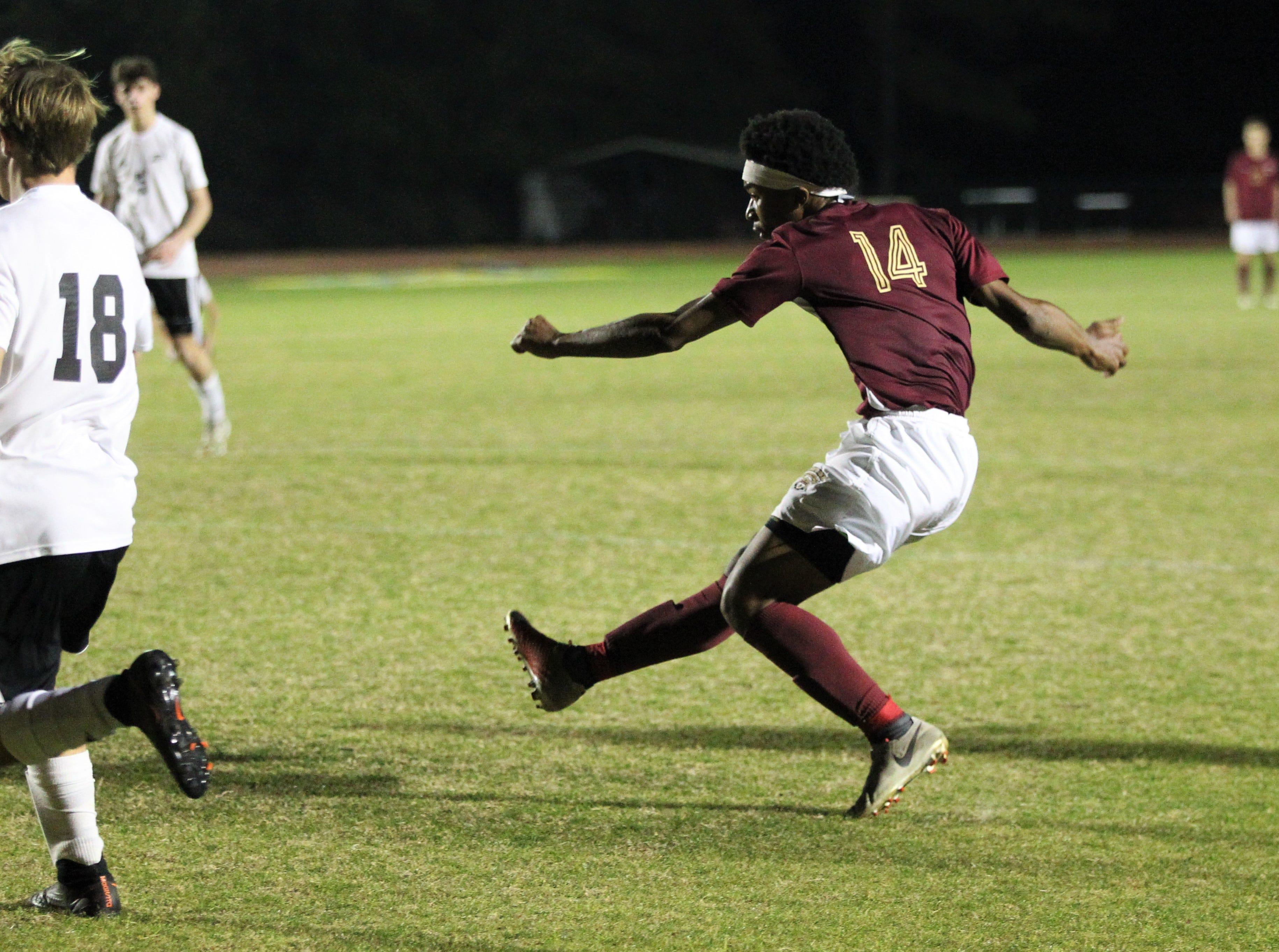 Florida High's Burnic Jordan takes a shot that sails over goal as Florida High's boys soccer team beat South Walton 2-0 during a Region 1-2A quarterfinal on Feb. 6, 2018.