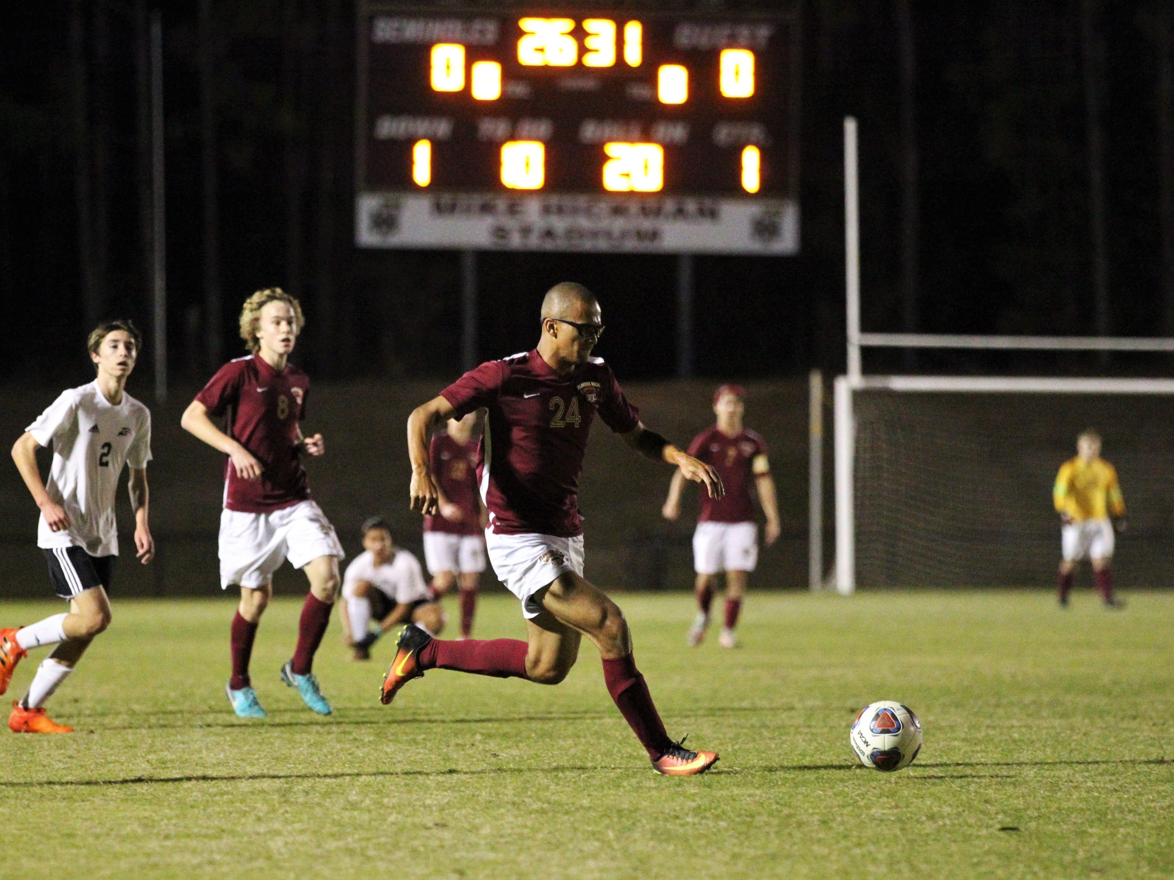 Florida High's Kelan Simmons races upfield as Florida High's boys soccer team beat South Walton 2-0 during a Region 1-2A quarterfinal on Feb. 6, 2018.
