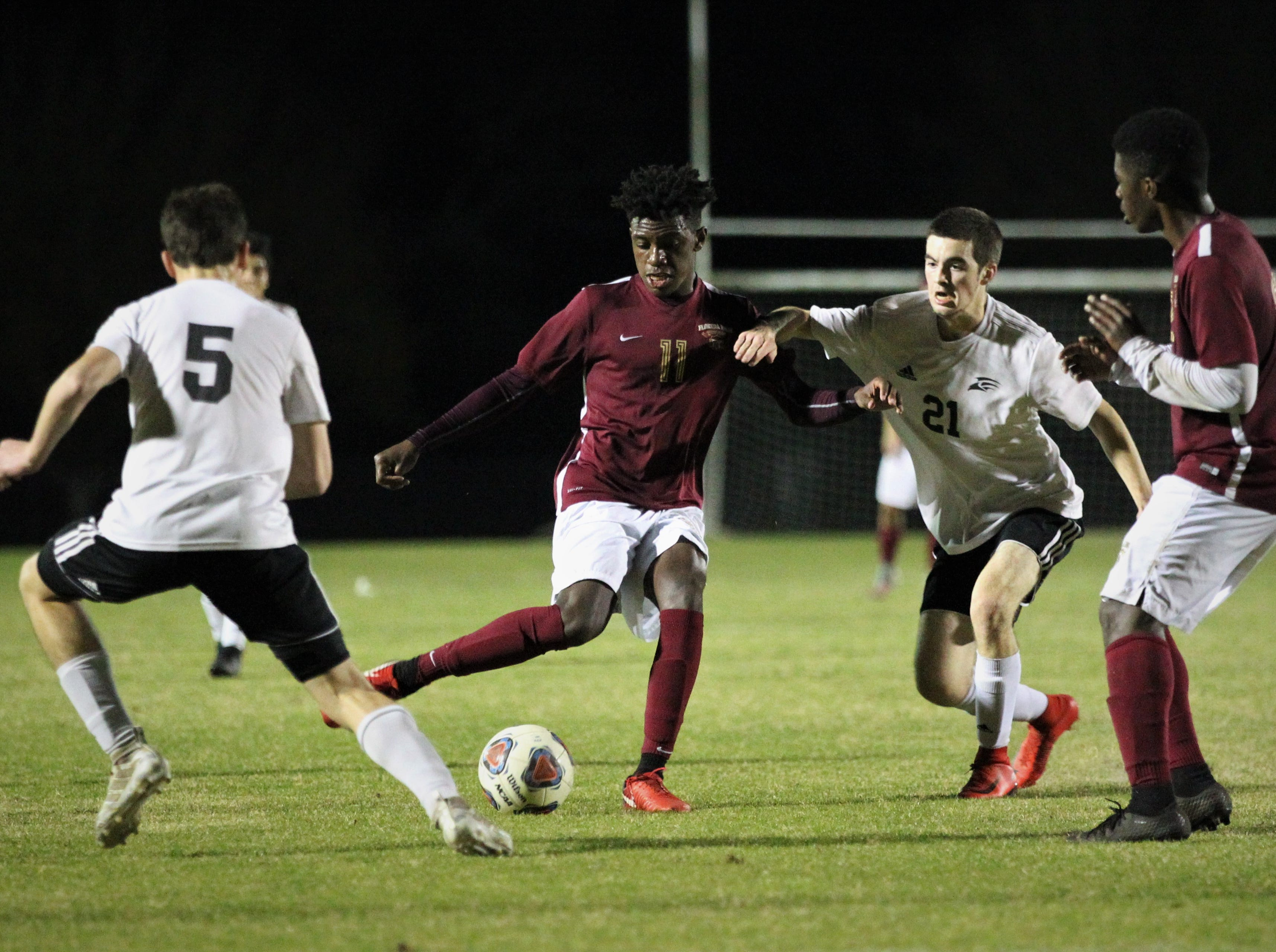 Florida High's Zuri Robertson makes a pass as Florida High's boys soccer team beat South Walton 2-0 during a Region 1-2A quarterfinal on Feb. 6, 2018.