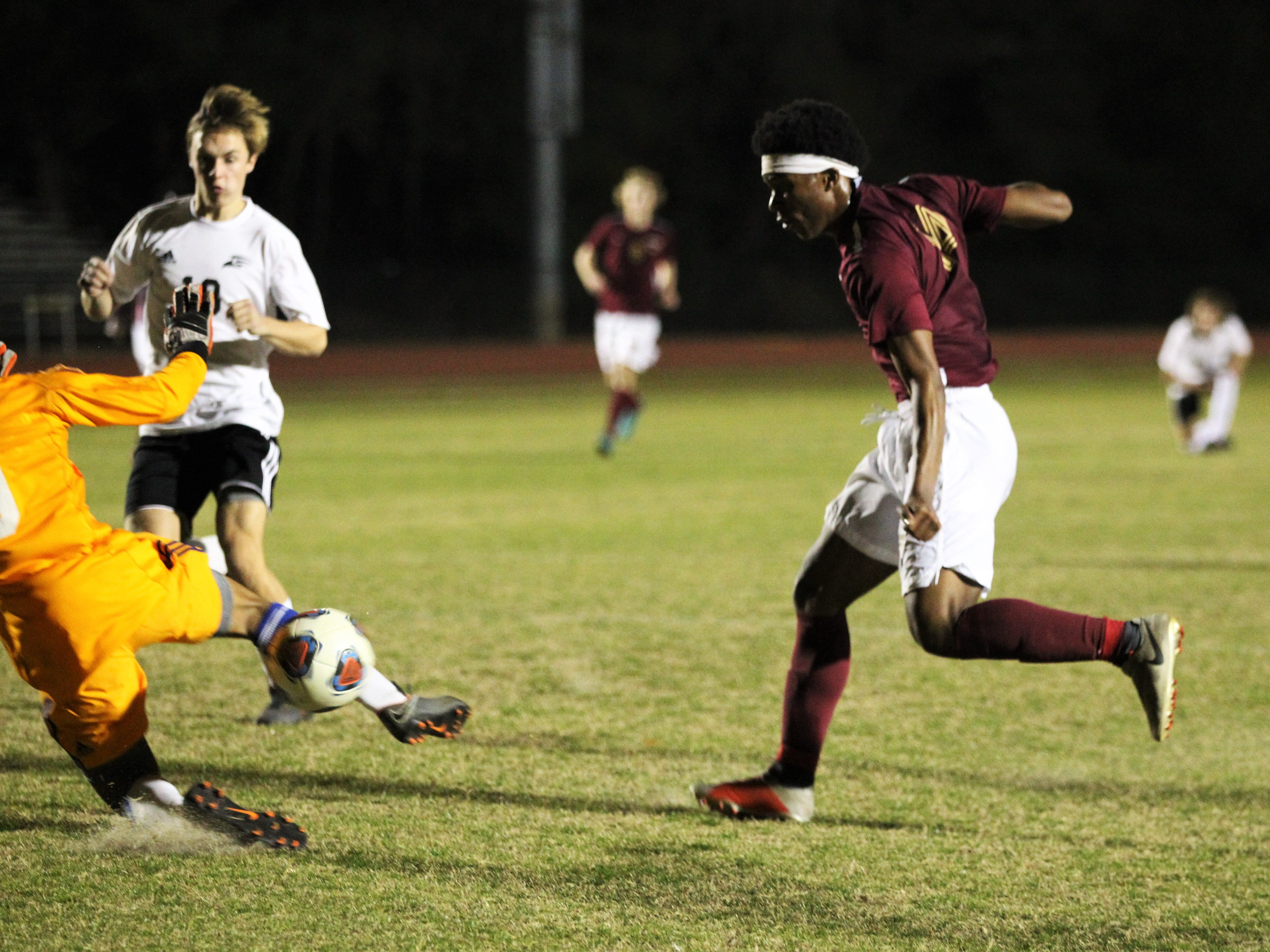 Florida High's Burnic Jordan takes a shot that is barely saved as Florida High's boys soccer team beat South Walton 2-0 during a Region 1-2A quarterfinal on Feb. 6, 2018.