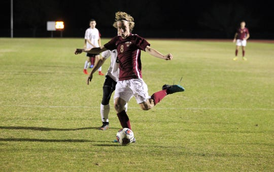 Florida High's Beecher Lewis sets up a pass in the box as Florida High's boys soccer team beat South Walton 2-0 during a Region 1-2A quarterfinal on Feb. 6, 2018.