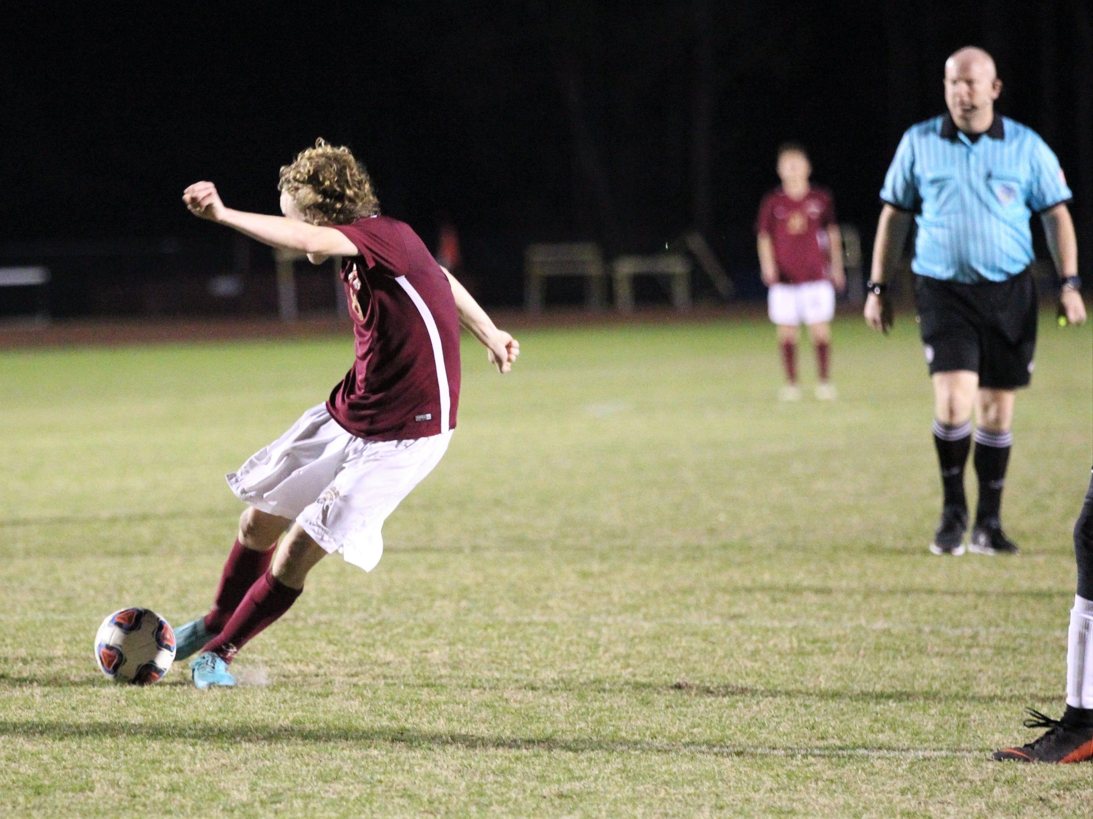 Florida High's Beecher Lewis rips a shot for a goal as Florida High's boys soccer team beat South Walton 2-0 during a Region 1-2A quarterfinal on Feb. 6, 2018.