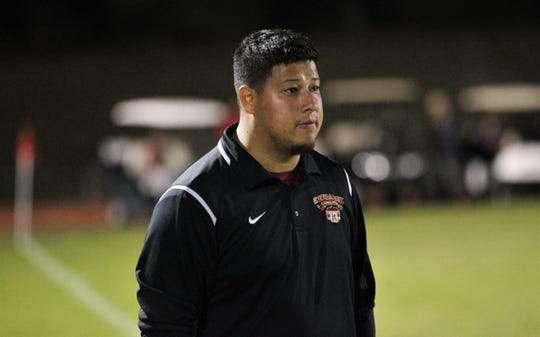 Florida High boys soccer coach Manuel Rico watches as the Seminoles beat South Walton 2-0 during a Region 1-2A quarterfinal on Feb. 6, 2018.