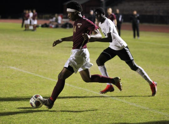 Florida High's Burnic Jordan dribbles into the box as Florida High's boys soccer team beat South Walton 2-0 during a Region 1-2A quarterfinal on Feb. 6, 2018.