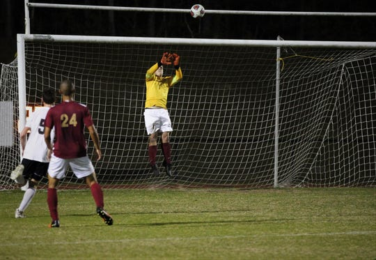 Florida High keeper Hayden Farrell goes airborne to make a save as Florida High's boys soccer team beat South Walton 2-0 during a Region 1-2A quarterfinal on Feb. 6, 2018.