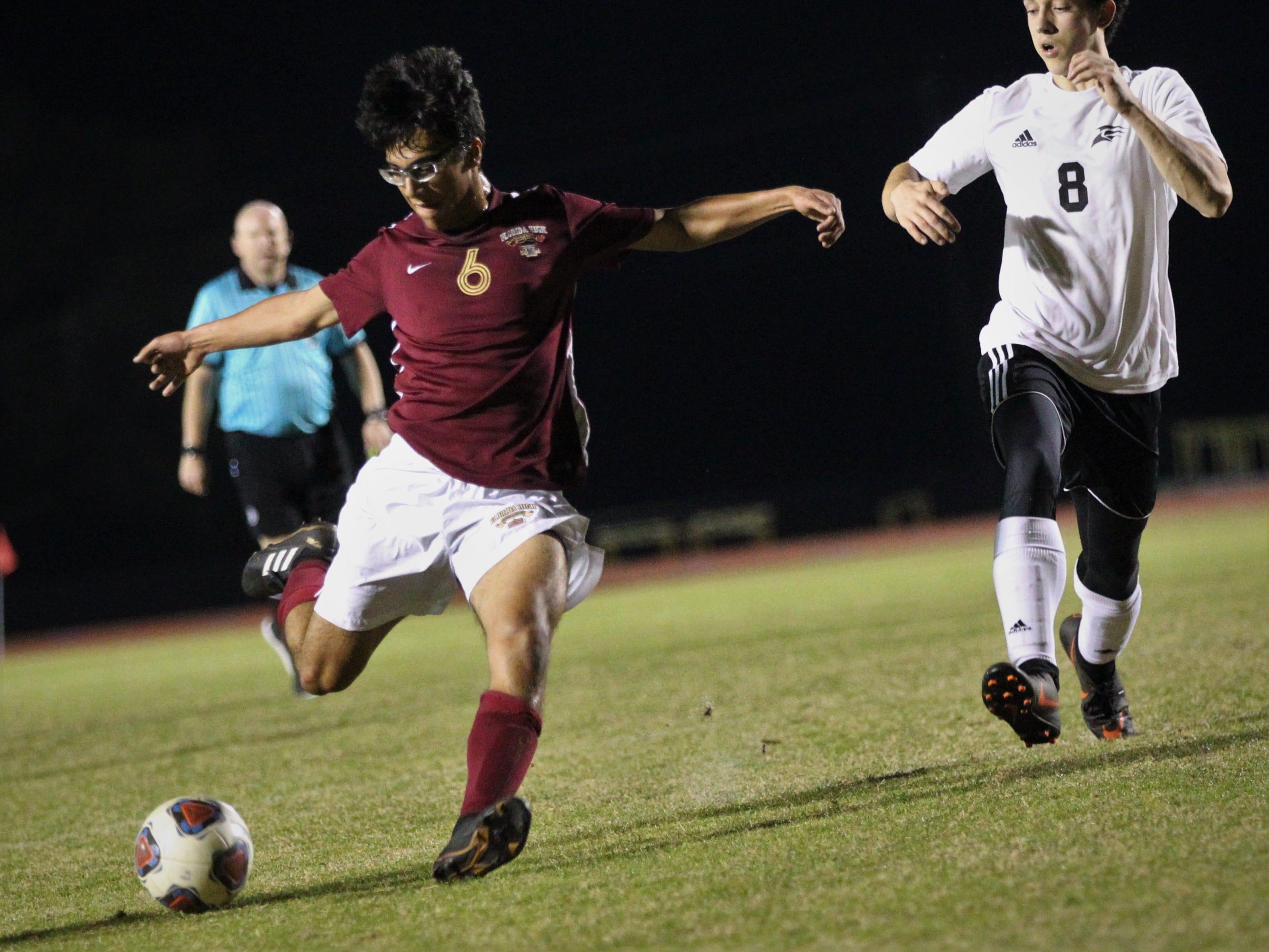 Florida High's Justin Garcia takes a shot on goal as Florida High's boys soccer team beat South Walton 2-0 during a Region 1-2A quarterfinal on Feb. 6, 2018.