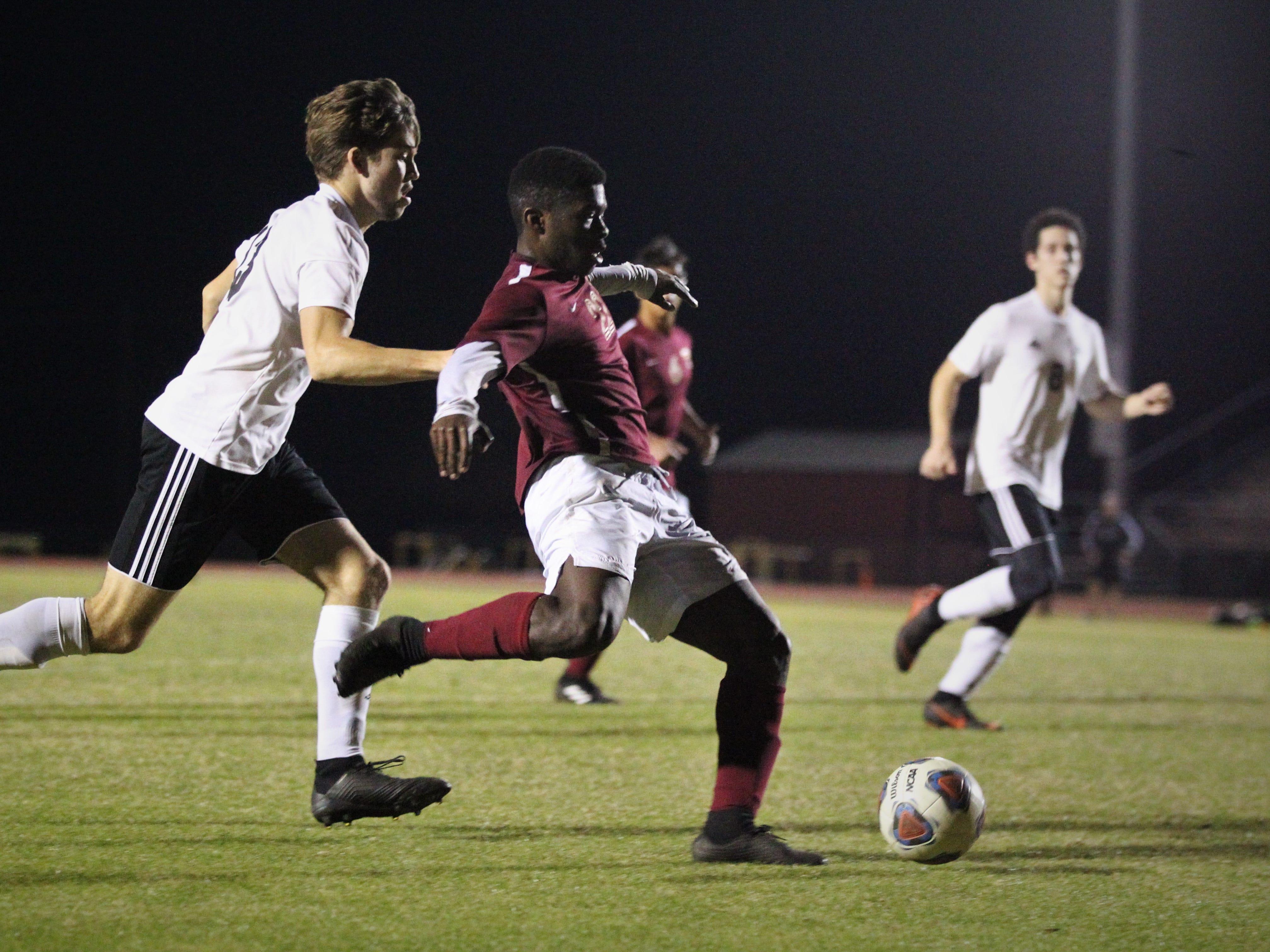 Florida High's Delali Simpson takes a shot on goal as Florida High's boys soccer team beat South Walton 2-0 during a Region 1-2A quarterfinal on Feb. 6, 2018.