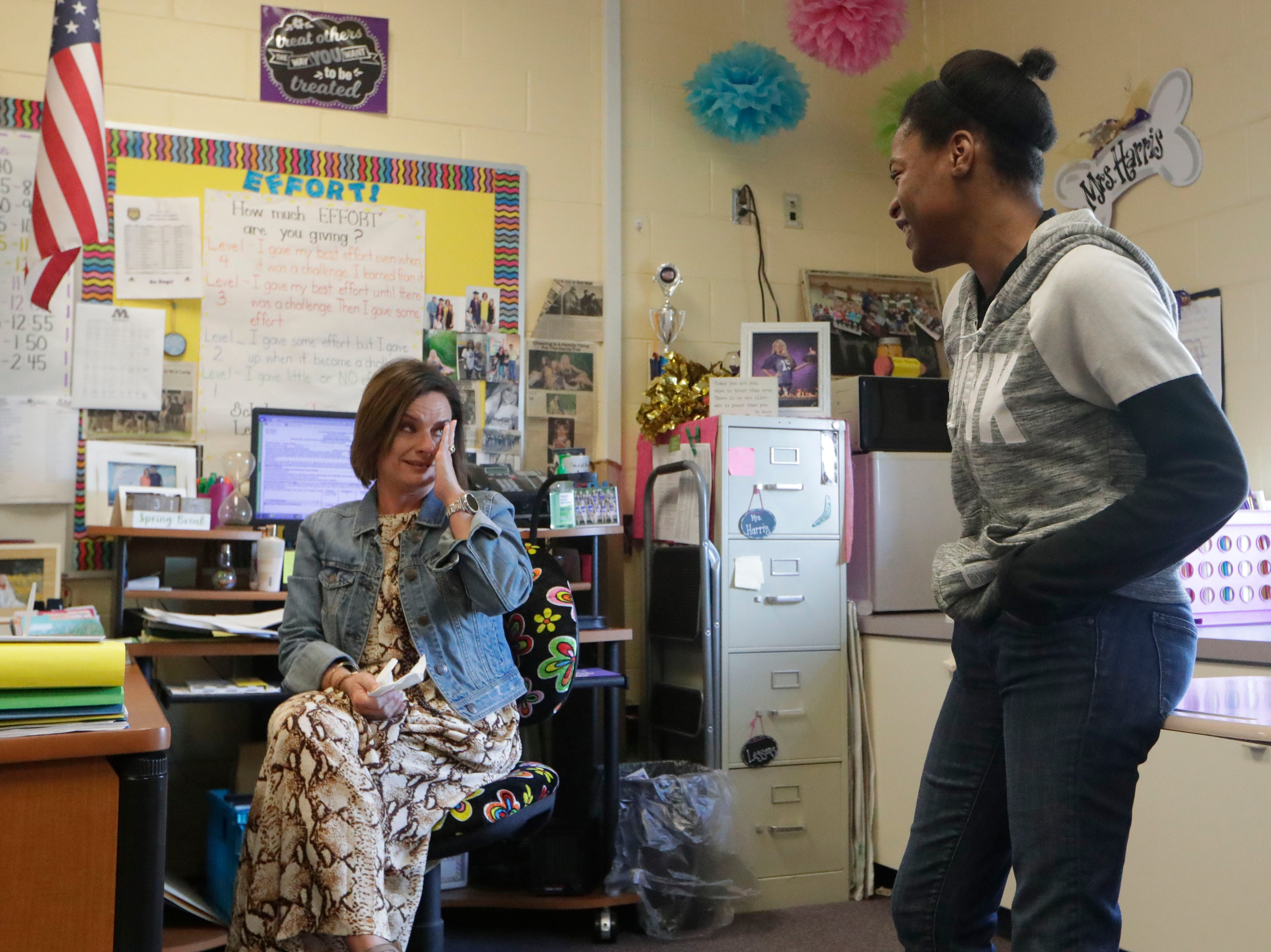 Jay-Hda McGriff, right, shares why Brandi Harris, left, is her favorite teacher at Marianna High School, Thursday Feb. 7, 2019. Harris has helped McGriff and her family since Hurricane Michael left them without a home and even more so since the passing of McGriff's mother in January.