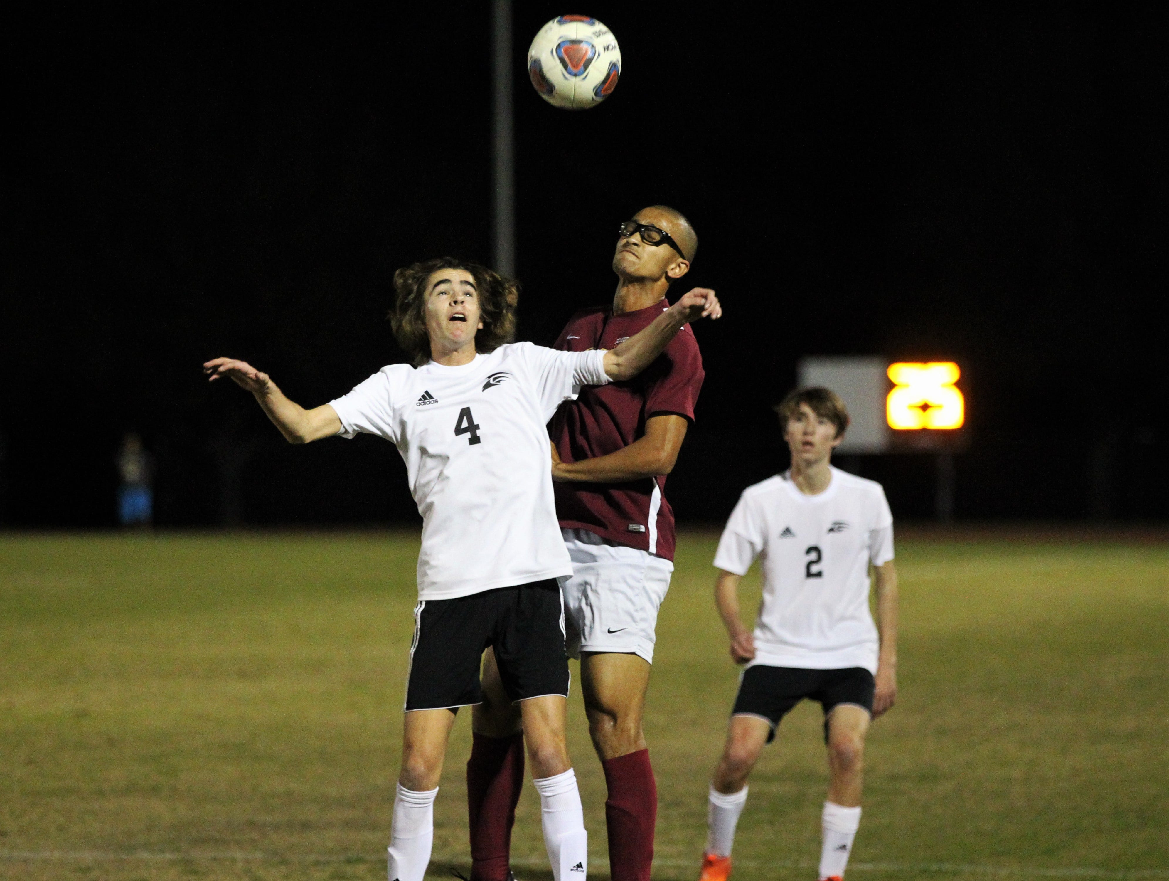 Florida High's Kelan Simmons goes up for a 50/50 ball as Florida High's boys soccer team beat South Walton 2-0 during a Region 1-2A quarterfinal on Feb. 6, 2018.