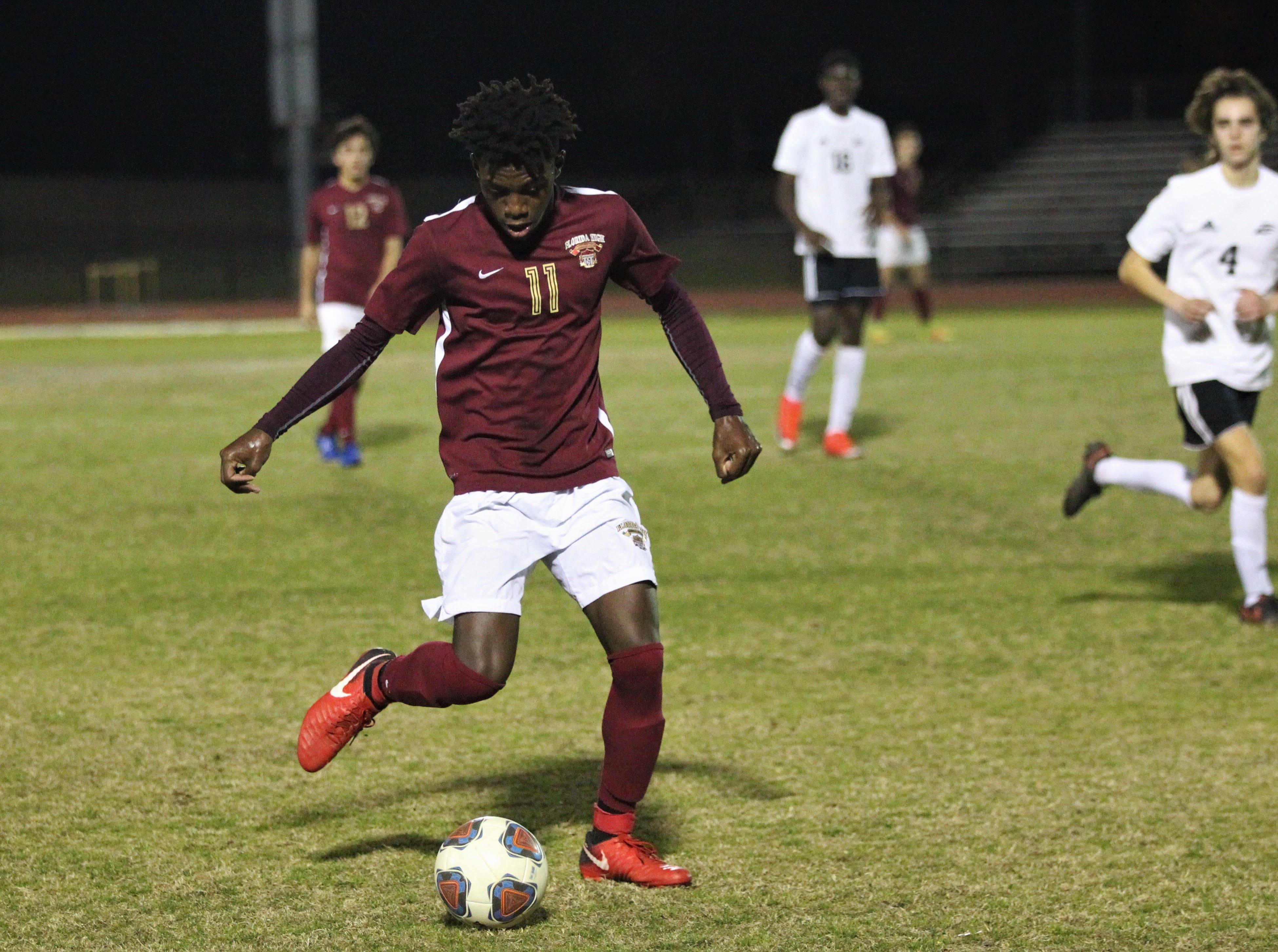 Florida High's Zuri Robertson makes a pass ahead as Florida High's boys soccer team beat South Walton 2-0 during a Region 1-2A quarterfinal on Feb. 6, 2018.
