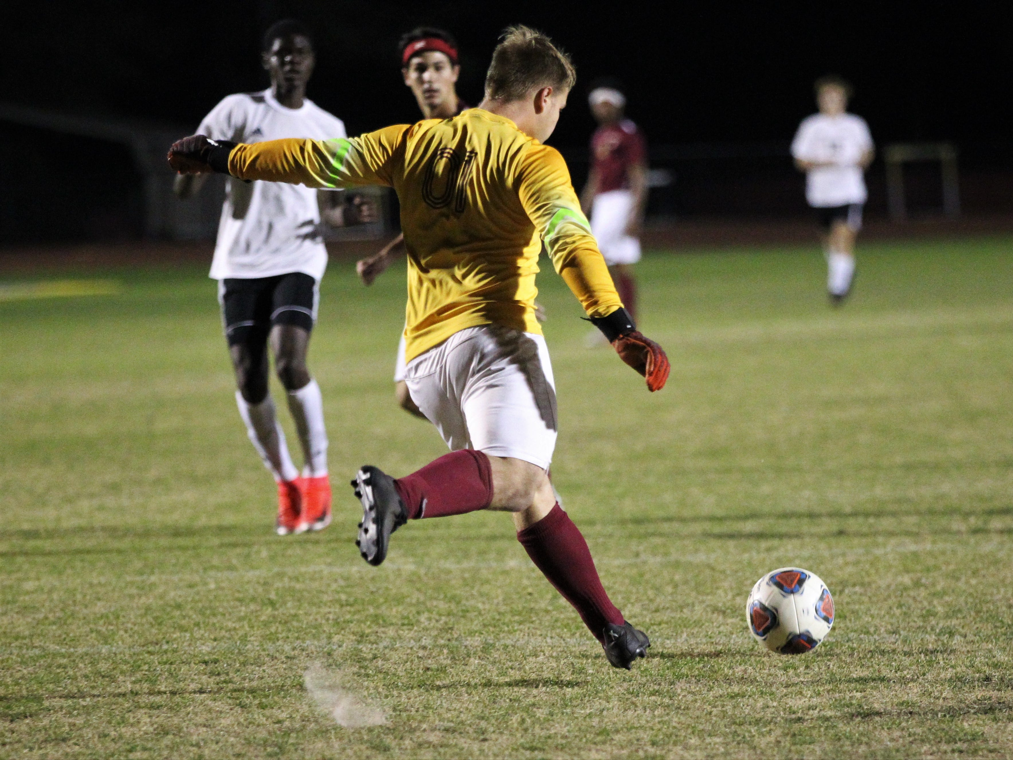 Florida High keeper Hayden Farrell clears a ball as Florida High's boys soccer team beat South Walton 2-0 during a Region 1-2A quarterfinal on Feb. 6, 2018.