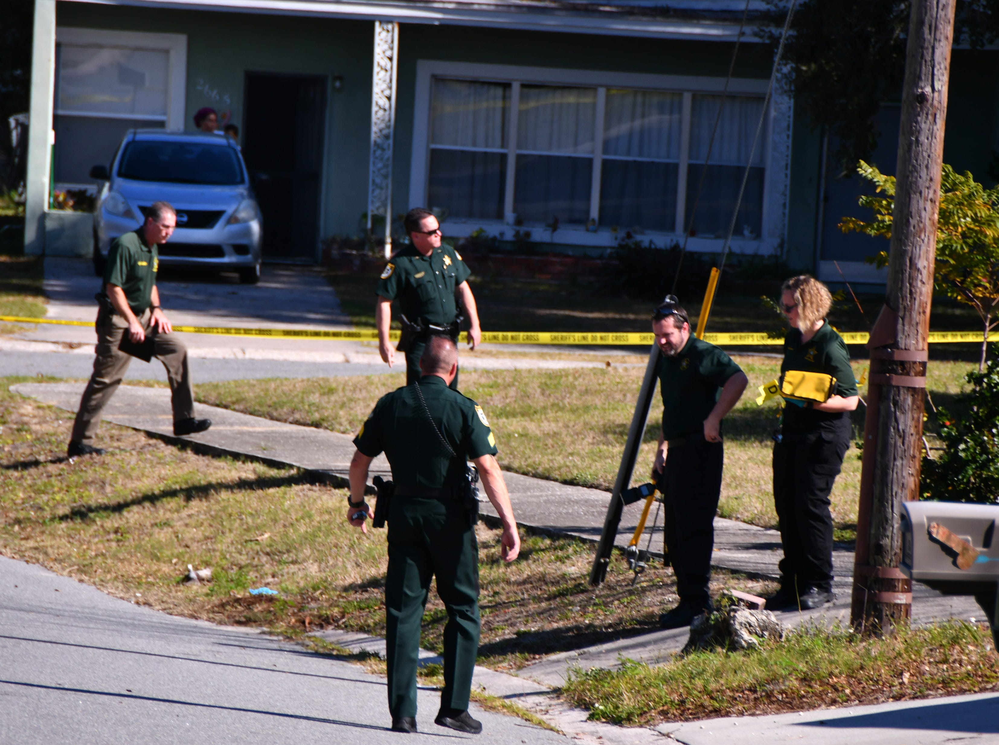 BCSO agents, deputies and crime scene technicians at the scene off a home invasion on West Court in Mims that left two people dead.