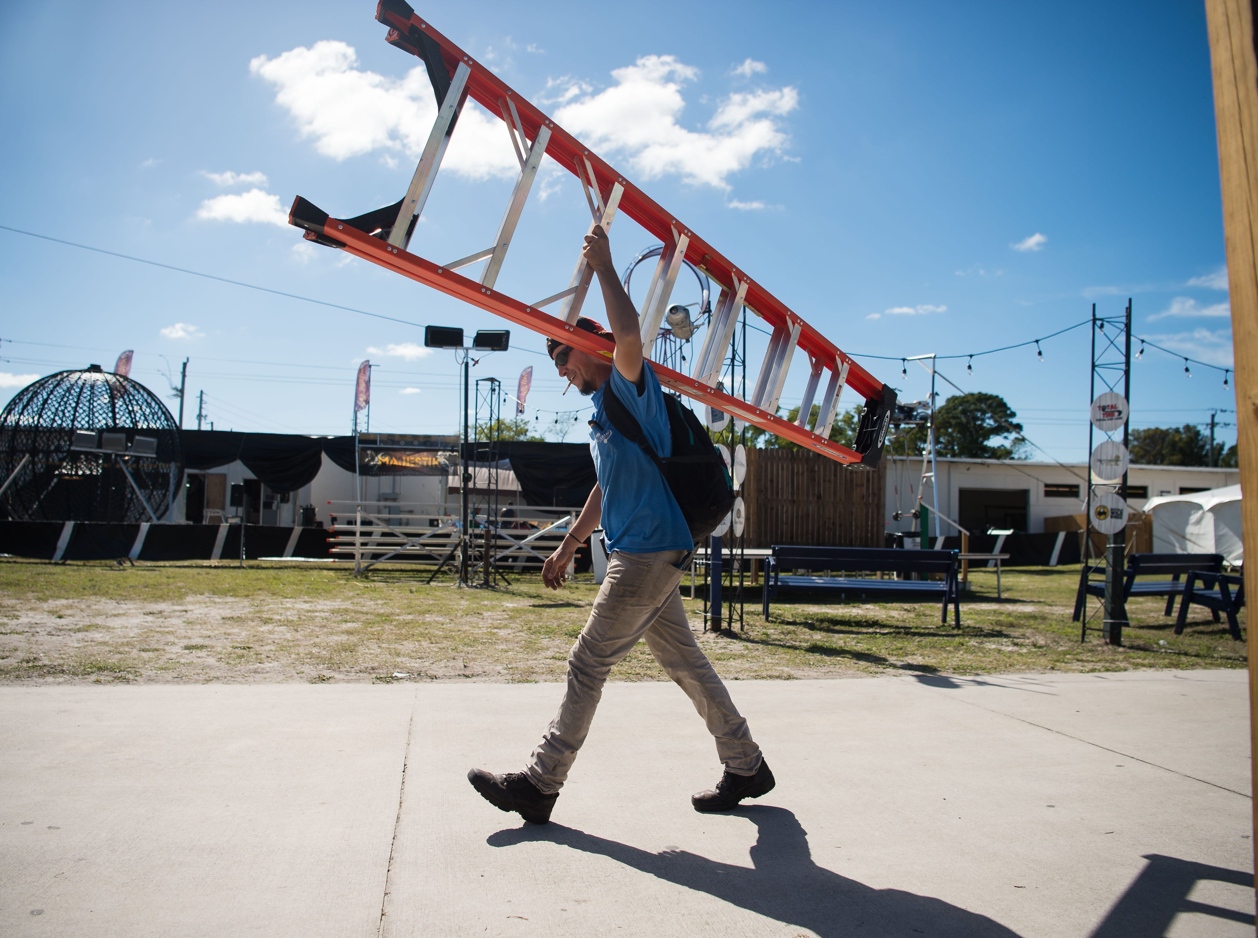 People work at the Martin County Fairgrounds to set up Thursday, Feb. 7, 2019, for the fair's opening on Southeast Dixie Highway on Friday in Stuart.