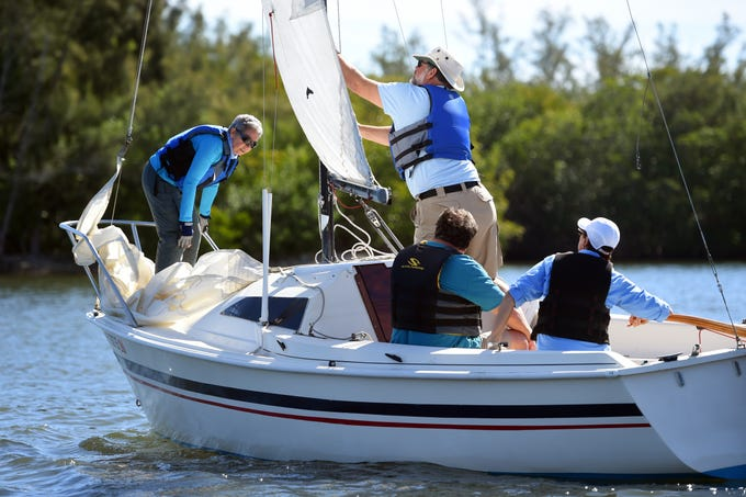 """Violante Fioravanti (from left), George Ebert and Susan Wilkins begin their third session of intermediate adult sailing lessons through the Youth Sailing Foundation of Indian River County with instructor Roy Timpe (standing) on Thursday, Feb. 7, 2019 in the Indian River Lagoon. Each student receives 12 hours of instruction and can choose from beginner or intermediate lessons. """"Most of our beginner sailors come to us with no experience,"""" said sailing instructor Kym Helwig. """"Maybe they were on a boat as a kid. But I would say that maybe 80 percent have never been out on the water so we really start from the basics."""" Adult lessons cost $350 and all the proceeds go to help fund the free sailing instruction offered to children of Indian River County."""