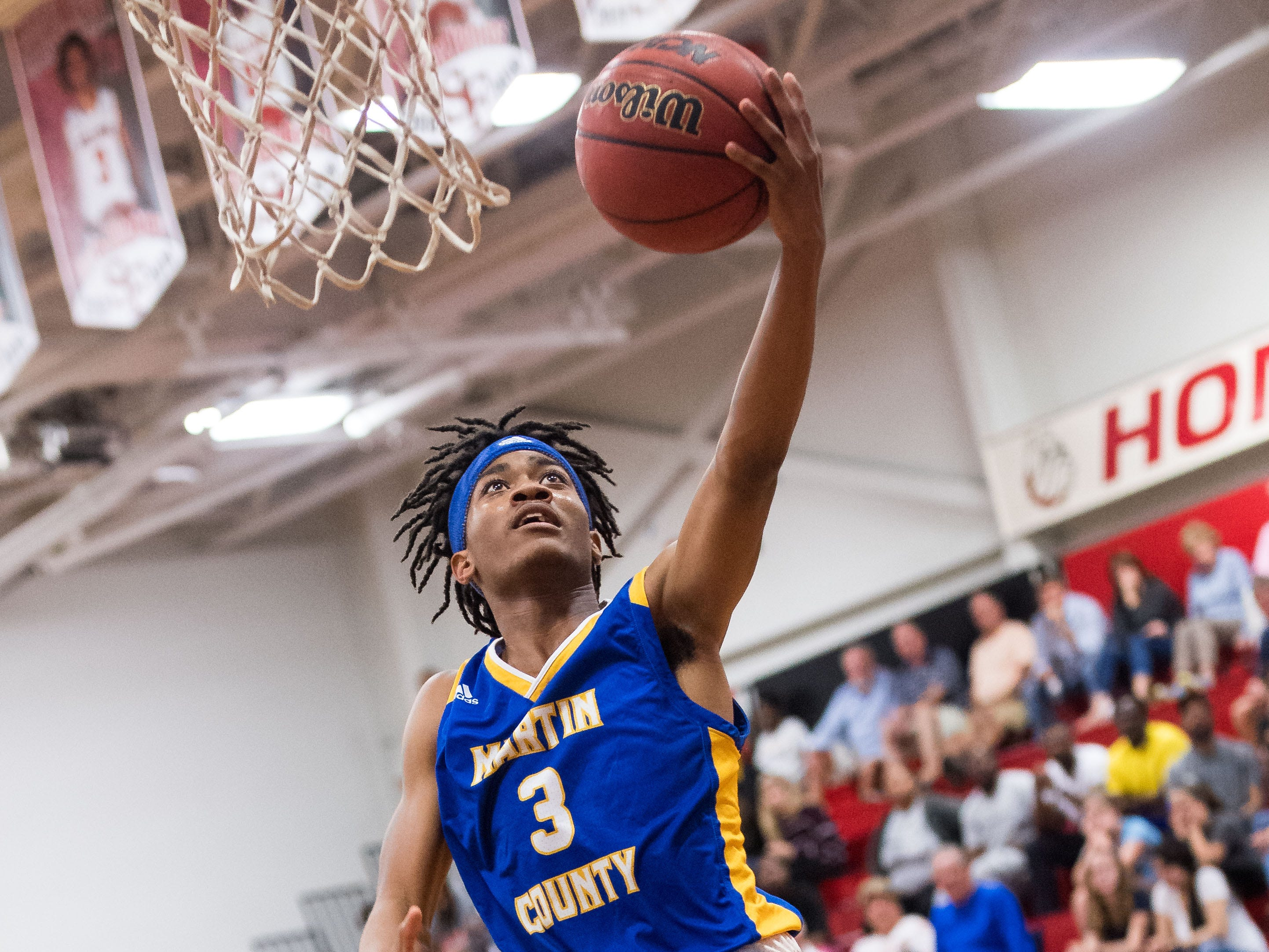 Martin County's Jevo Brown goes up for a shot in the third period against Martin County during the high school boys basketball game Wednesday, Feb. 6, 2019, at South Fork High School in Tropical Farms.