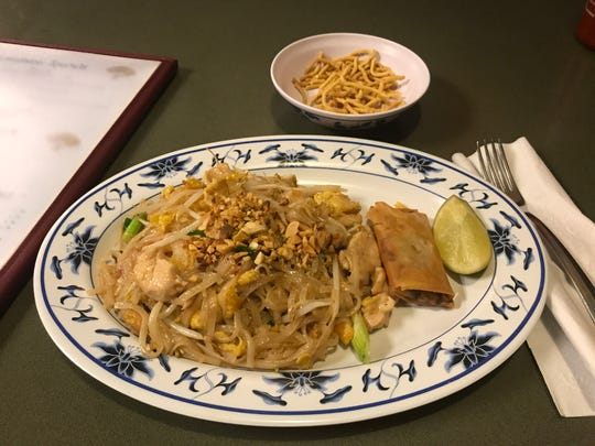 The Pad Thai lunch features noodles in a tasty peanut sauce with chicken and shrimp and a crispy roll.