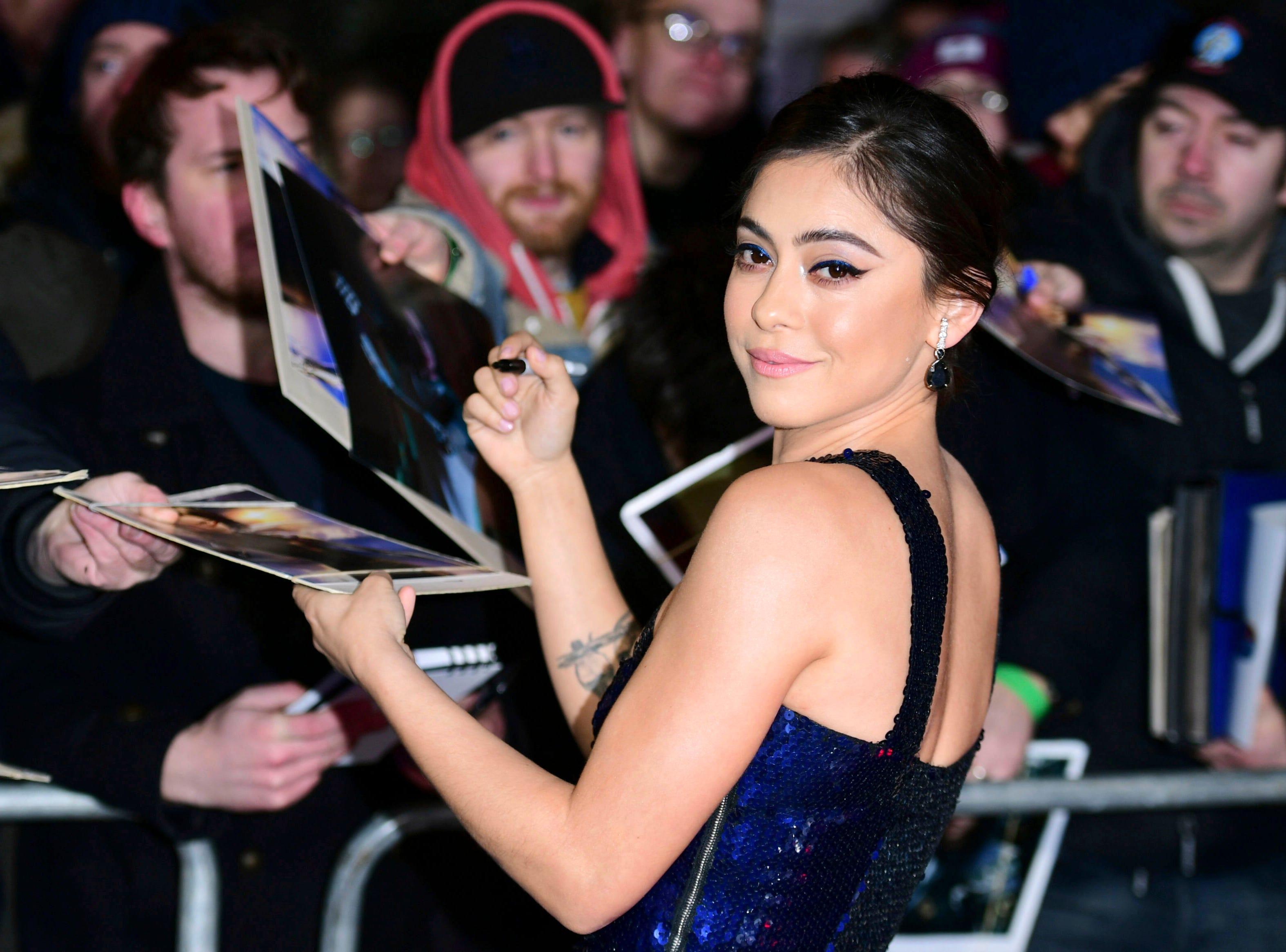"""Actress Rosa Salazar poses for the media while interacting with fans at the world premiere of """"Alita: Battle Angel"""" in central London, Thursday, Jan. 31, 2019."""