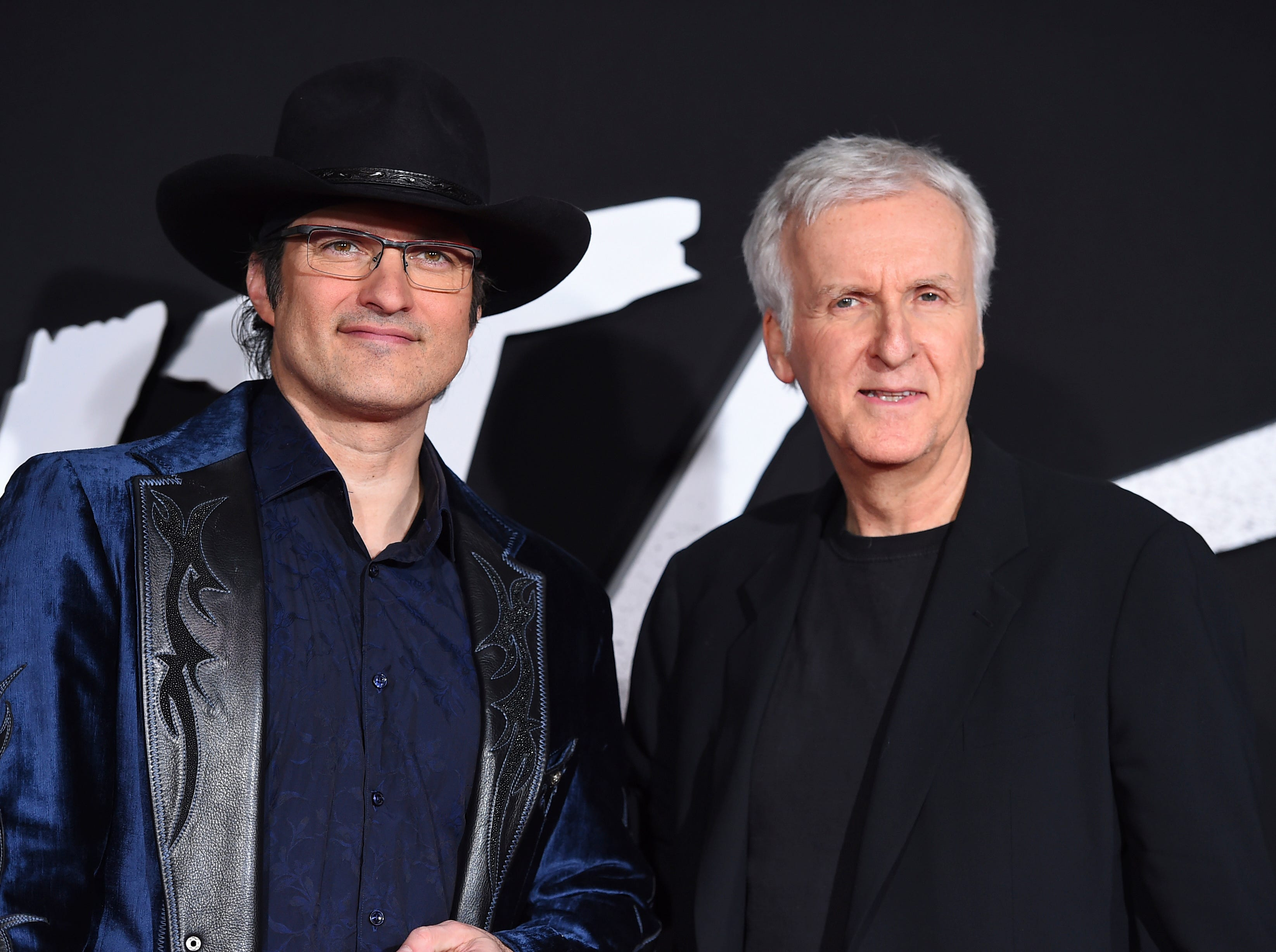 "Director Robert Rodriguez, left, and producer James Cameron arrive at the Los Angeles premiere of ""Alita: Battle Angel"" on Tuesday, Feb. 5, 2019."