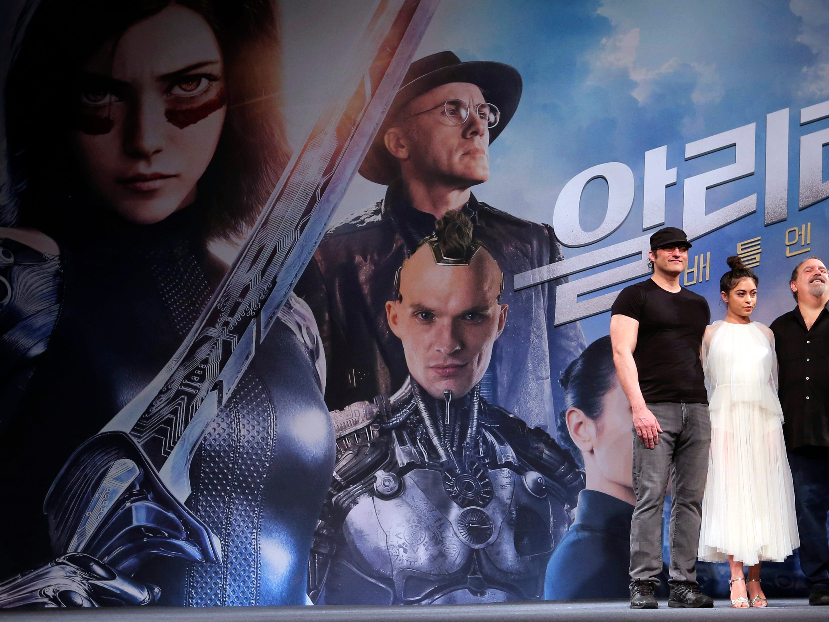 "Director Robert Rodriguez, left, actress Rosa Salazar and producer Jon Landau pose during a press conference to promote their new film ""Alita: Battle Angel"" in Seoul, South Korea, Thursday, Jan. 24, 2019."