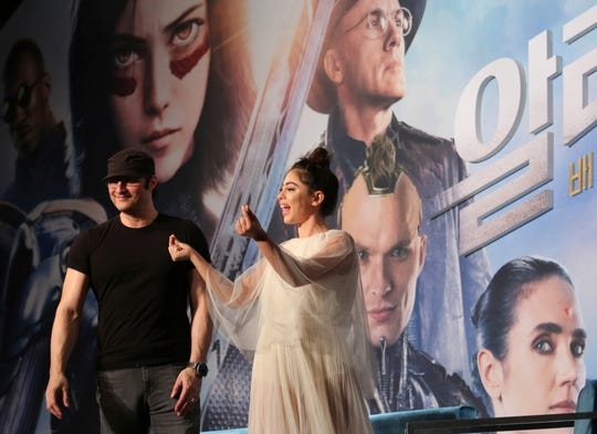 "Director Robert Rodriguez and actress Rosa Salazar leave after a news conference to promote their new film ""Alita: Battle Angel"" in Seoul, South Korea, Thursday, Jan. 24, 2019."