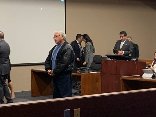 Former El Paso priest Miguel Luna stands before Judge Maria Salas-Mendoza at a hearing Wednesday in the 120th District Court. Luna is charged with six counts of aggravated sexual assault of a child, and three counts each of sexual assault of a child and indecency with a child -sexual contact.