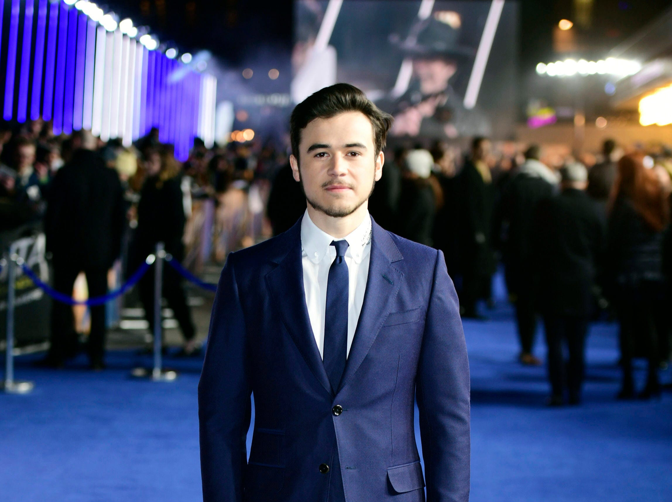 "Actor Keean Johnson poses for the media at the world premiere of ""Alita: Battle Angel"" in central London, Thursday, Jan. 31, 2019."
