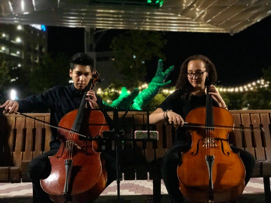 Roussel XX, and Mia Gonzales perfom regularly for pedestrians at the San Jacinto Plaza.