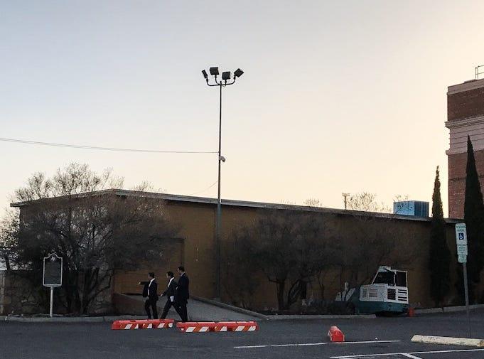 Men walk along the El Paso County Coliseum grounds on Wednesday, Feb. 6, 2019.