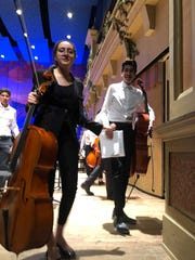 Mia Gonzales and Roussel Acosta get ready to perform one of their outdoor concerts.