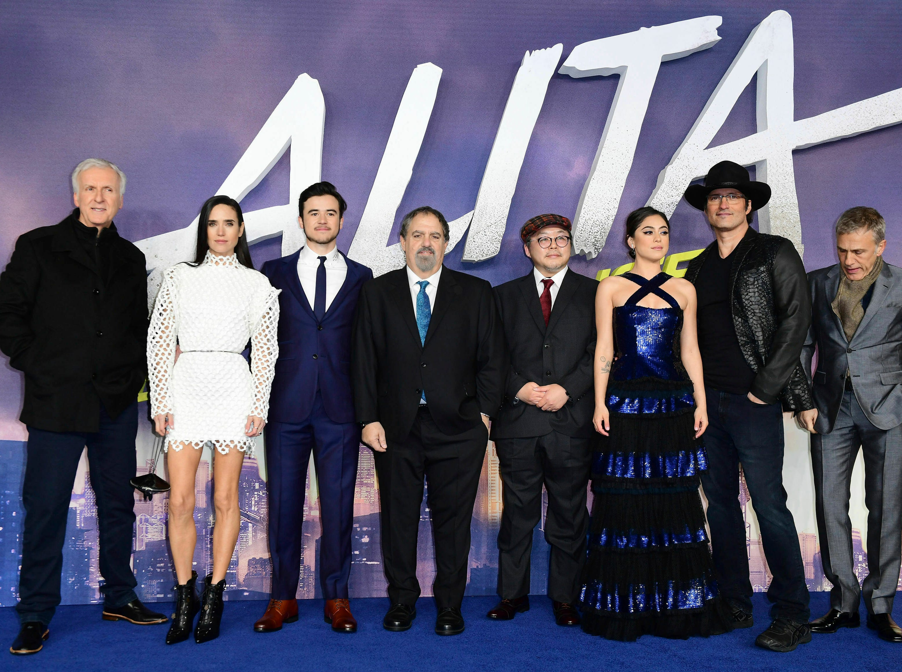 "The cast and crew pose for the media at the world premiere of ""Alita: Battle Angel"" in central London, Thursday, Jan. 31, 2019."
