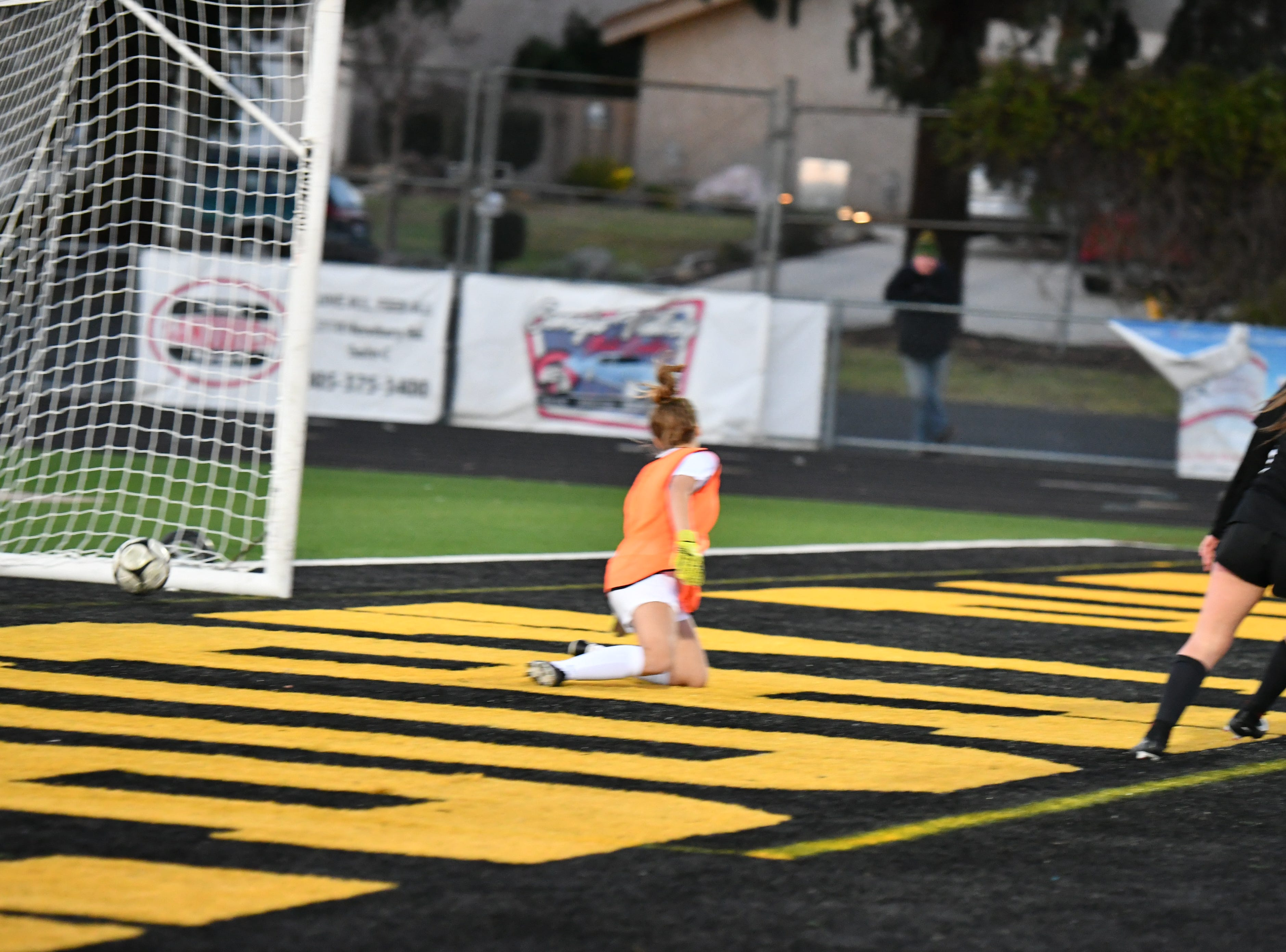 Newbury Park senior Kaitlyn McKeown finishes her second of three goals against Royal on Wednesday in the first round of the CIF-Southern Section Division 2 playoffs at Newbury Park High. Newbury Park won, 3-0.