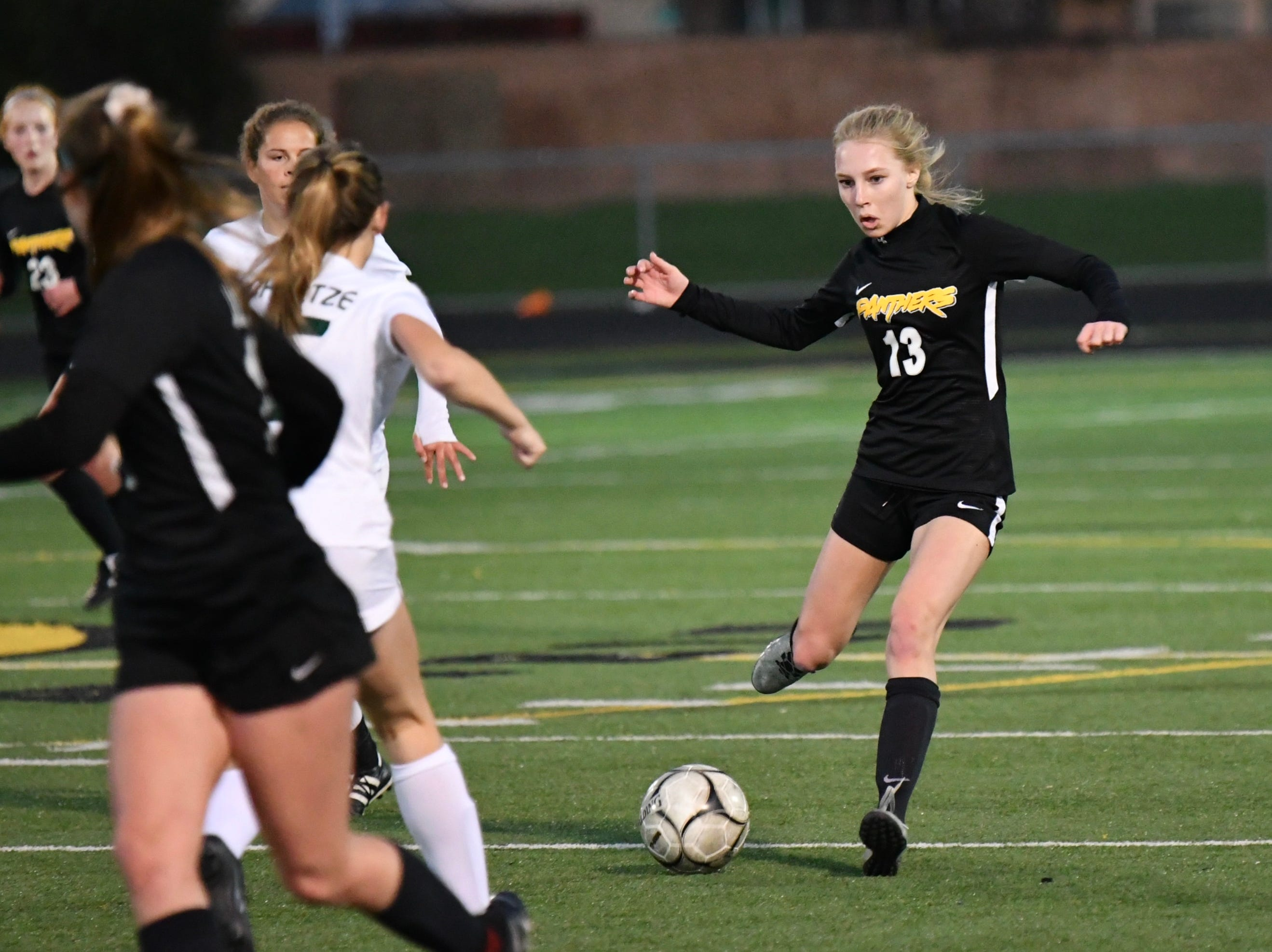 Newbury Park senior Cami Davis looks up for a teammate  on Wednesday night against Royal in the first round of the CIF-Southern Section Division 2 playoffs at Newbury Park High. Newbury Park won, 3-0.