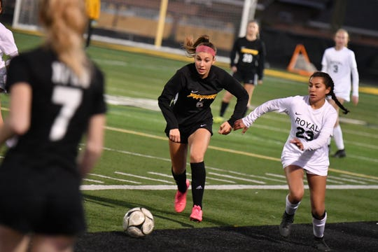 Newbury Park's Fiona Marangola, left, and Royal's Kamryn Izquierdo battle for possession on Wednesday in the first round of the CIF-Southern Section Division 2 playoffs at Newbury Park High. Newbury Park won, 3-0.