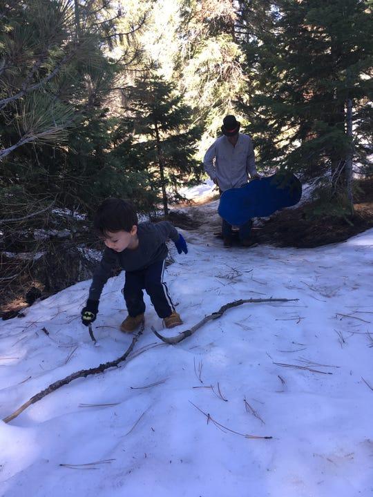 A Ventura family enjoys the snow near Mount Pinos.