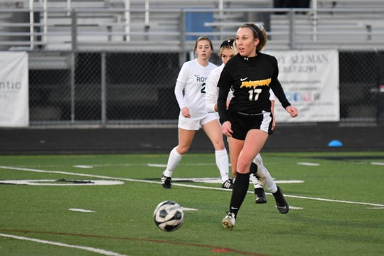 Newbury Park senior Carly McConville looks upfield for a teammate against Royal High on Wednesday in the first round of the CIF-Southern Section Division 2 playoffs at Newbury Park High. Newbury Park won, 3-0.