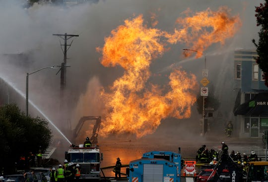 San Francisco firefighters battle a fire on Geary Boulevard on  Wednesday. A gas explosion shot flames high into the air and was burning several buildings as utility crews scrambled to shut off the flow of gas. Construction workers cut a natural gas line.