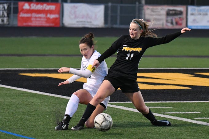 Newbury Park senior Kaitlyn McKeown (11) and Royal senior Jenna Sakamoto battle for possession on Wednesday in the first round of the CIF-Southern Section Division 2 playoffs at Newbury Park High. Newbury Park won, 3-0.