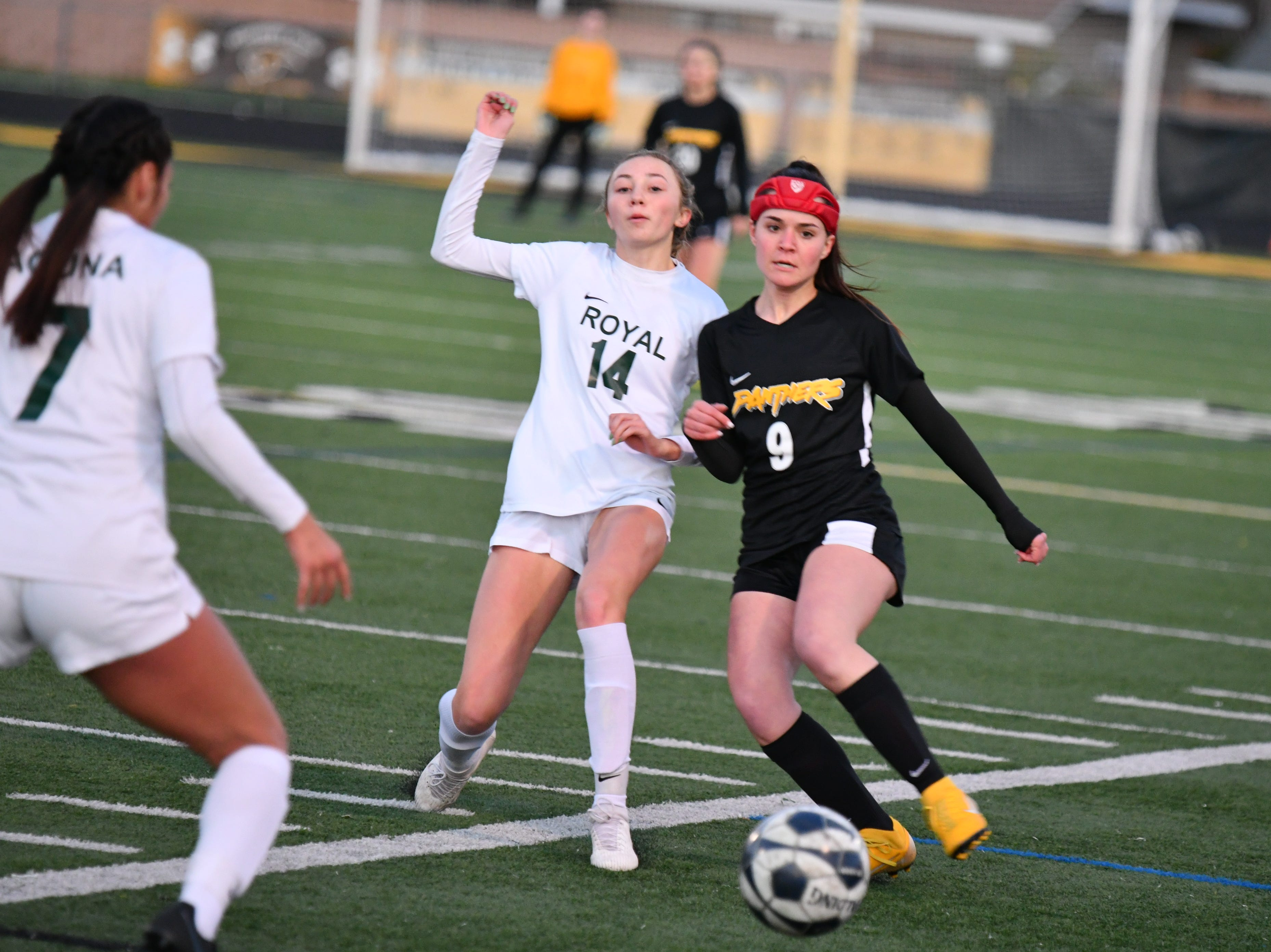 Royal's Grace Nilsen, left, and Newbury Park's Claudia Diliberti battle for possession on Wednesday in the first round of the CIF-Southern Section Division 2 playoffs at Newbury Park High. Newbury Park won, 3-0.