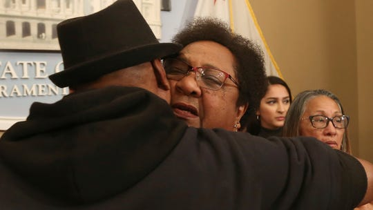 Assemblywoman Shirley Weber, D-San Diego, right, is hugged by Cephus Johnson, the uncle of Oscar Grant, who was killed by BART police n 2009. Weber announced a bill that would allow police to use deadly force only when there is no reasonable alternative.