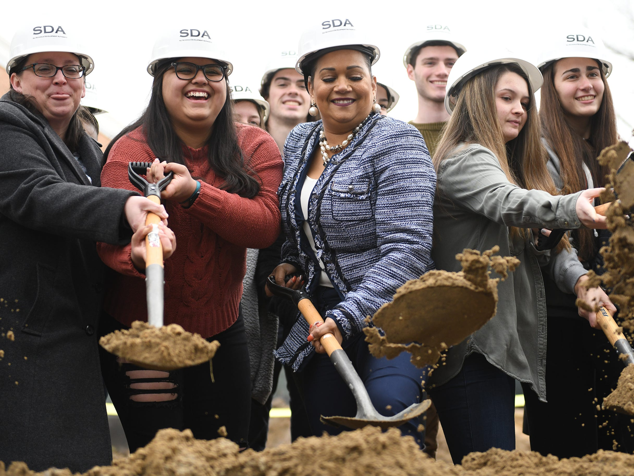 Lizette Delgado (center), CEO of the New Jersey Schools Development Authority, takes part in the groundbreaking ceremony at Millville High School on Thursday, Feb. 7, 2019.