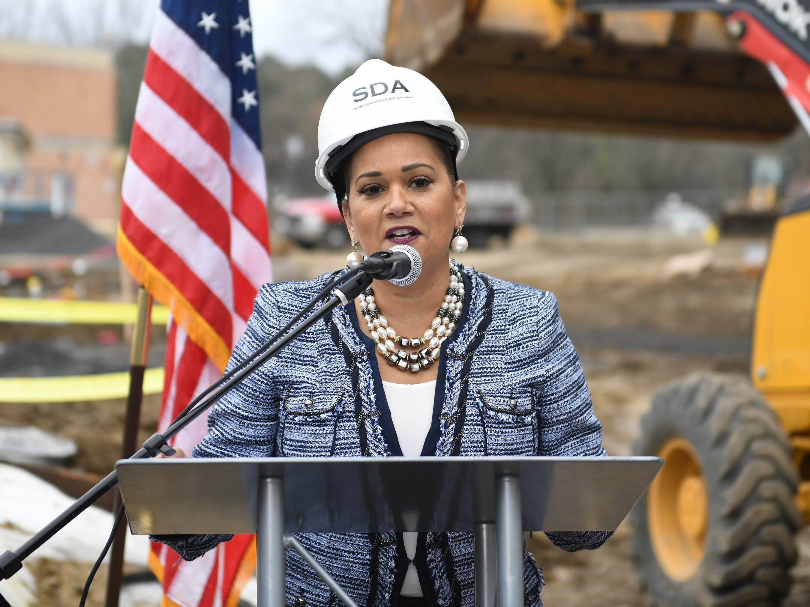 Lizette Delgado, CEO of the New Jersey Schools Development Authority, speaks during the groundbreaking ceremony at Millville High School on Thursday, Feb. 7, 2019.