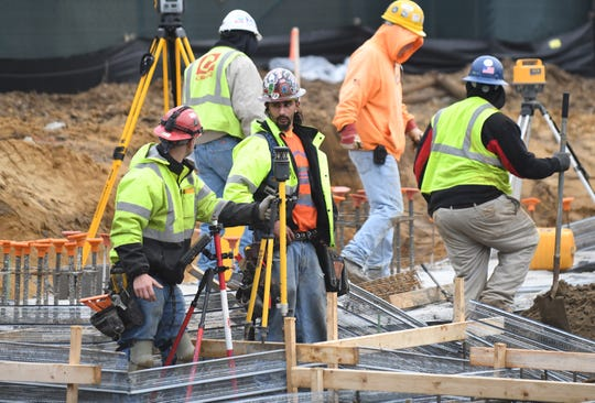Iron workers prepare the framework for the addition to Millville High School during a groundbreaking ceremony on Thursday, Feb. 7, 2019.