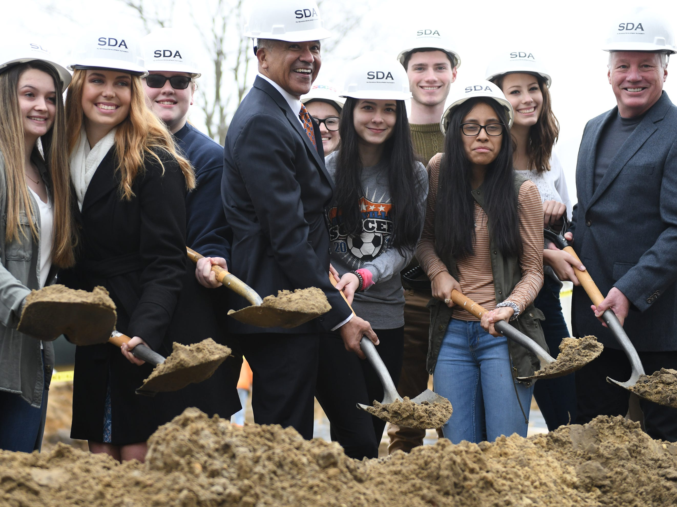 Millville Mayor Michael Santiago (center) takes part in the groundbreaking ceremony at Millville High School on Thursday, Feb. 7, 2019.