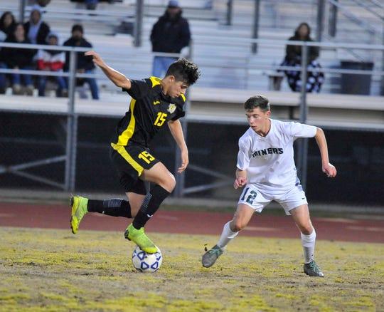 Golden West's Sebastian Caballero fakes out El Diamante's Dino Giannadrea at Groppetti Stadium on Feb 6, 2019.